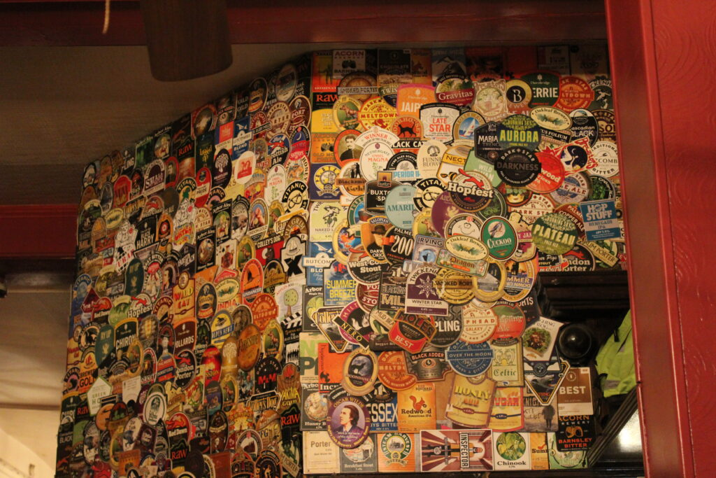 The Harp, Pump Clips Above The Bar. Tours of the UK